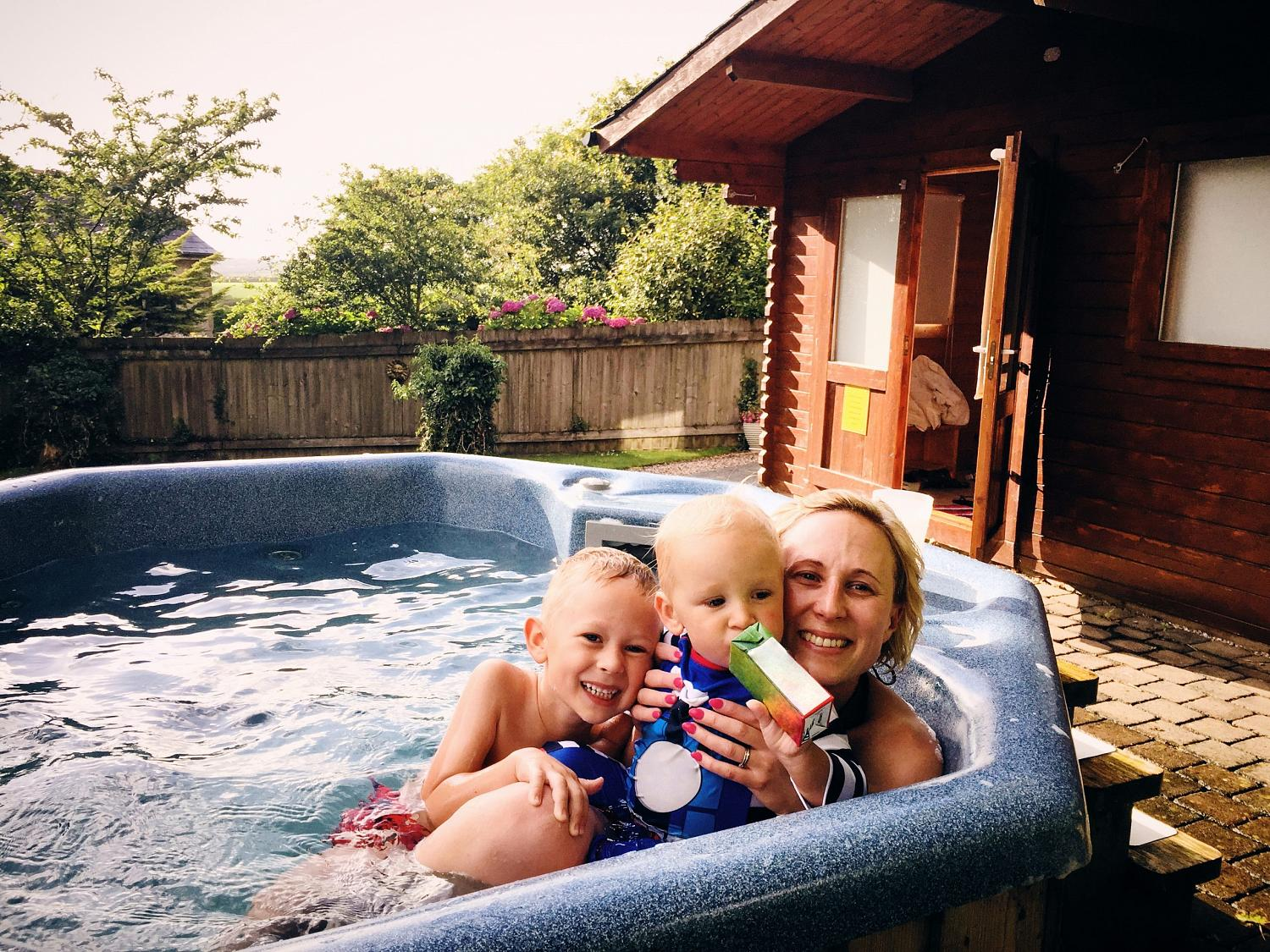 A mother and her sons in a hot tub