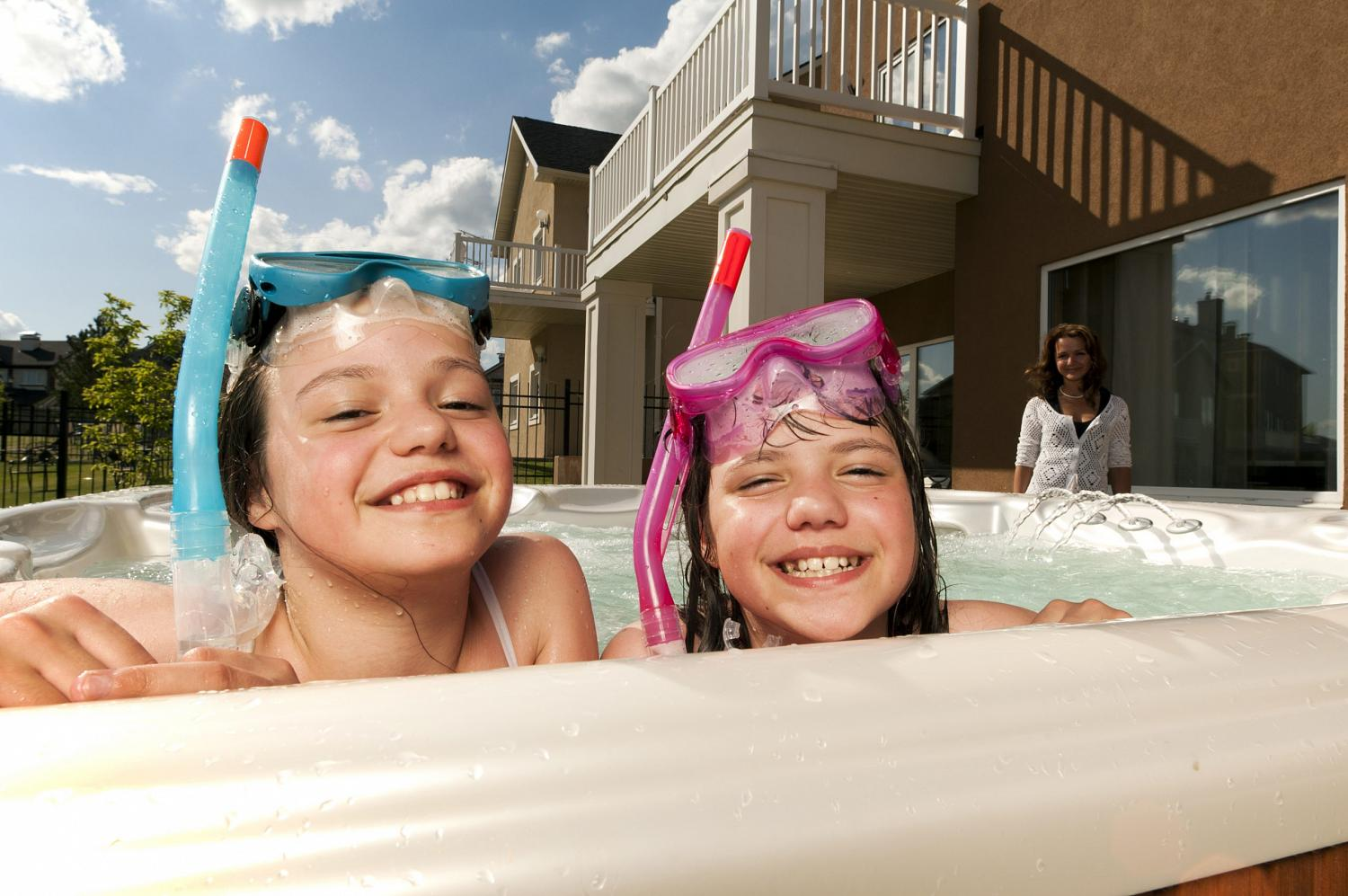 Two little girls have fun in a swim spa