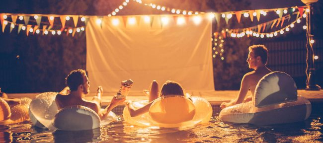 Night time pool and hot tub movie party