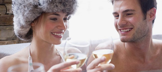 Couple in hot tub with wine