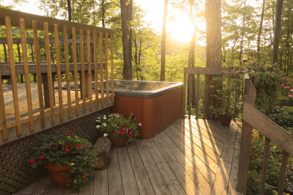 Surround your hot tub with a custom deck or patio