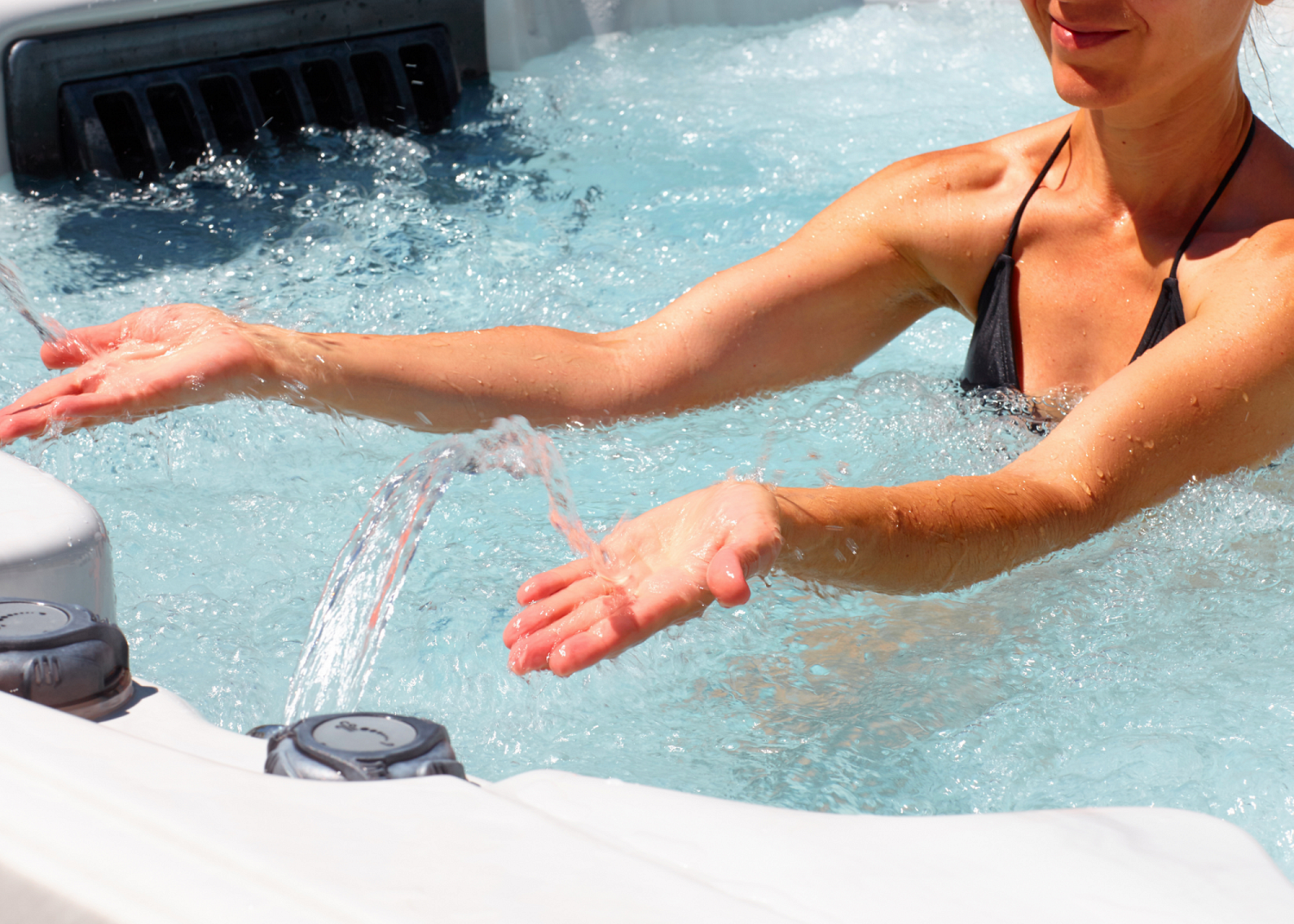 woman Playing in hot tub